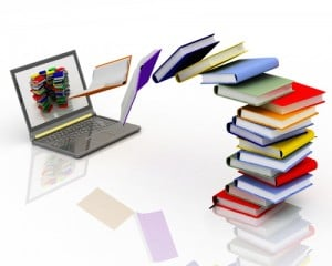 books into laptop1 300x240 What Are Your Go To Social Media Resources?
