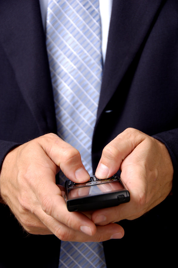 bigstock Business Man Working On Smart 1555662 Dont Let Thumbs Dominate Mobile Marketing