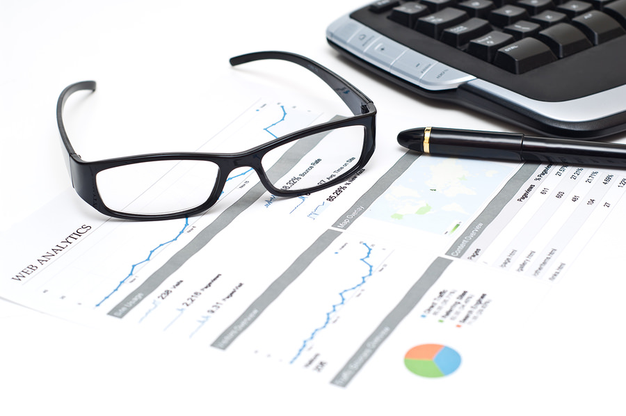 bigstock Glasses And Pen On A Printed W 11487599 5 Steps Required to Building a Best Practice Digital Analytics Function