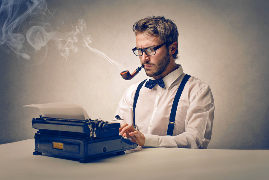 bigstock-handsome-journalist-writing-wi-43410031