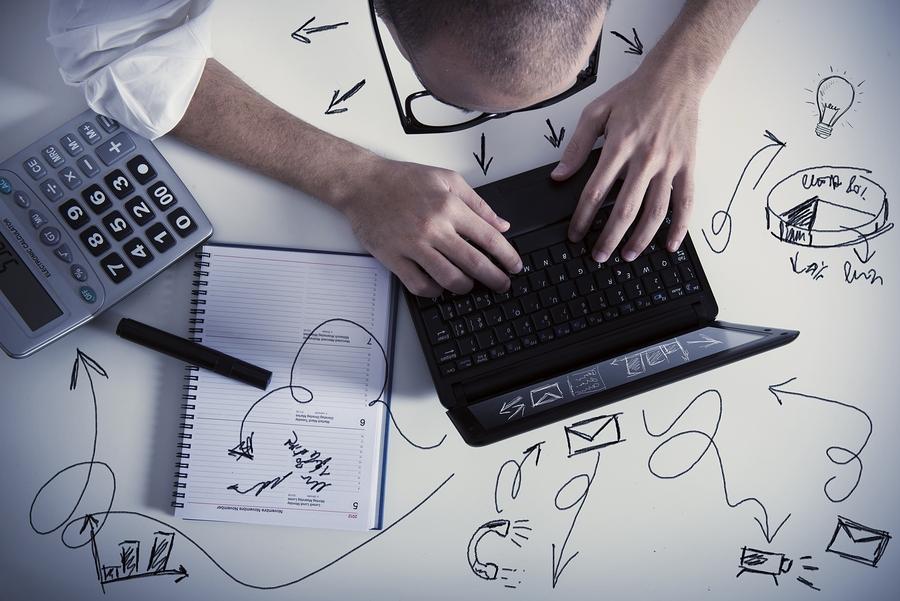 bigstock-Multitasking-Businessman-At-W-43237039
